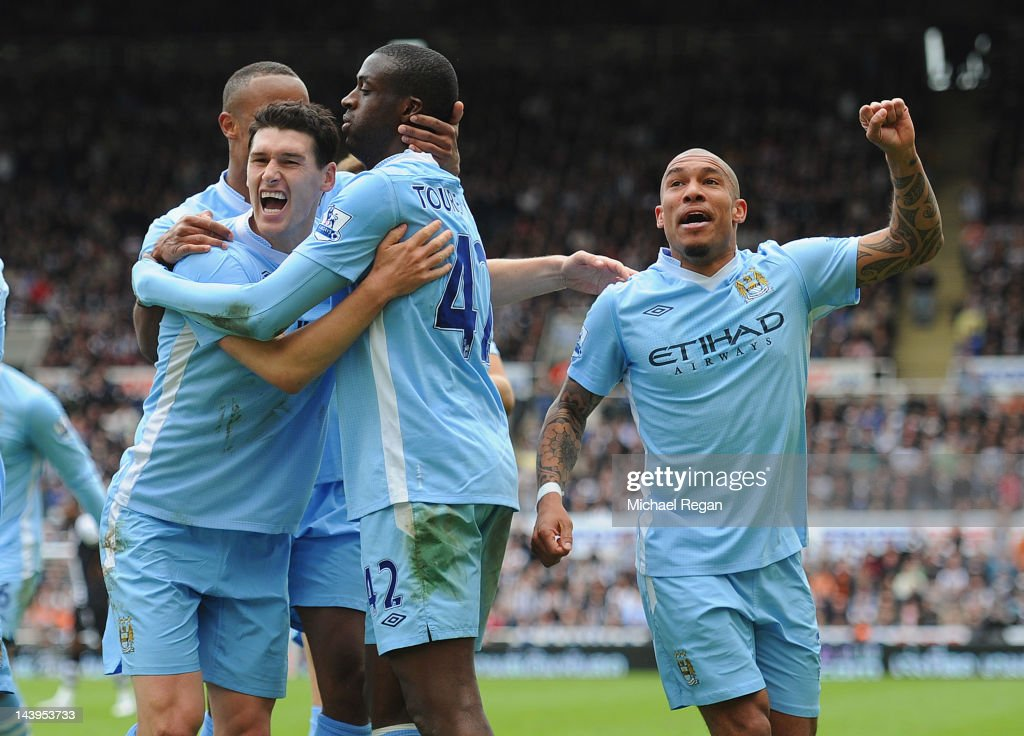 Yaya Toure of Manchester City celebrates scoring to make it 20 with team mates Nigel De Jong and Gareth Barry during the Barclays Premier League...