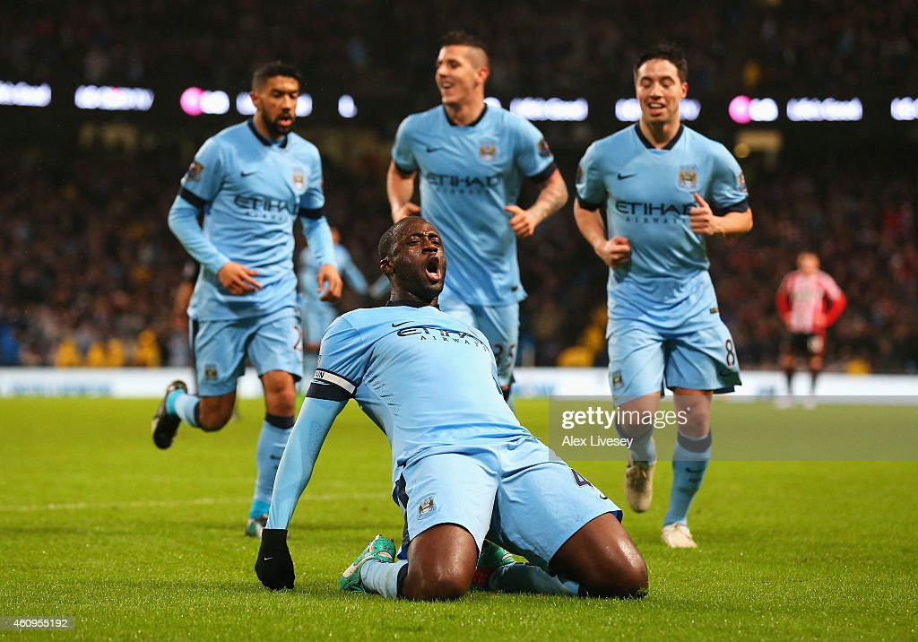 <a gi-track='captionPersonalityLinkClicked' href=/galleries/search?phrase=Yaya+Toure&family=editorial&specificpeople=550817 ng-click='$event.stopPropagation()'>Yaya Toure</a> of Manchester City celebrates the opening goal during the Barclays Premier League match between Manchester City and Sunderland at Etihad Stadium on January 1, 2015 in Manchester, England.