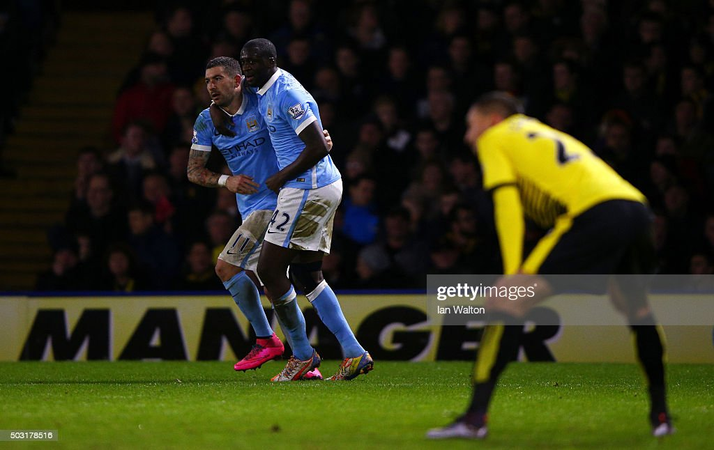 Yaya Toure of Manchester City celebrates with Aleksandar Kolarov of Manchester City after scoring his side's first goal during the Barclays Premier League match between Watford and Manchester City at Vicarage Road on January 2, 2016 in Watford, England.