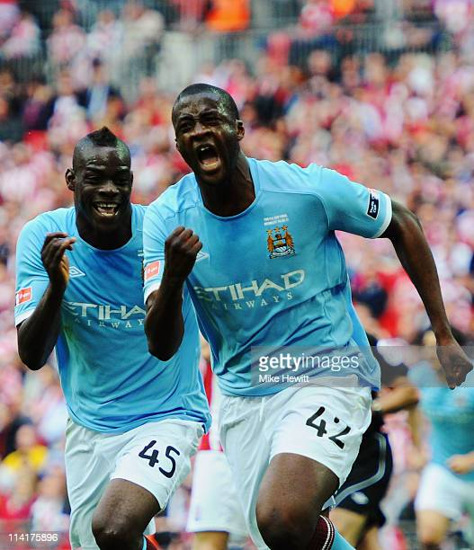 Yaya Toure of Manchester City celebrates with Mario Balotelli after scoring during the FA Cup sponsored by EON Final match between Manchester City...