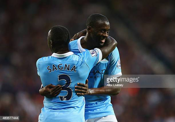 Yaya Toure of Manchester City celebrates with team mate Bacary Sagna as he scores their second goal during the Barclays Premier League match between...