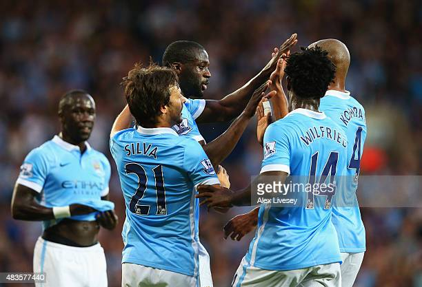 Yaya Toure of Manchester City celebrates with team mates as he scores their second goal during the Barclays Premier League match between West...