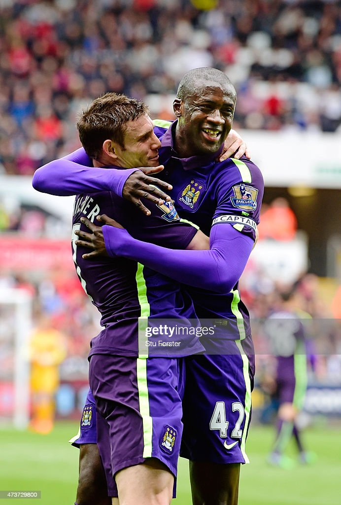 <a gi-track='captionPersonalityLinkClicked' href=/galleries/search?phrase=Yaya+Toure&family=editorial&specificpeople=550817 ng-click='$event.stopPropagation()'>Yaya Toure</a> (R) of Manchester City celebrates with teammate <a gi-track='captionPersonalityLinkClicked' href=/galleries/search?phrase=James+Milner+-+Soccer+Player&family=editorial&specificpeople=214576 ng-click='$event.stopPropagation()'>James Milner</a> of Manchester City after scoring the opening goal during the Barclays Premier League match between Swansea and Manchester City at the Liberty Stadium on May 17, 2015 in Swansea, Wales.