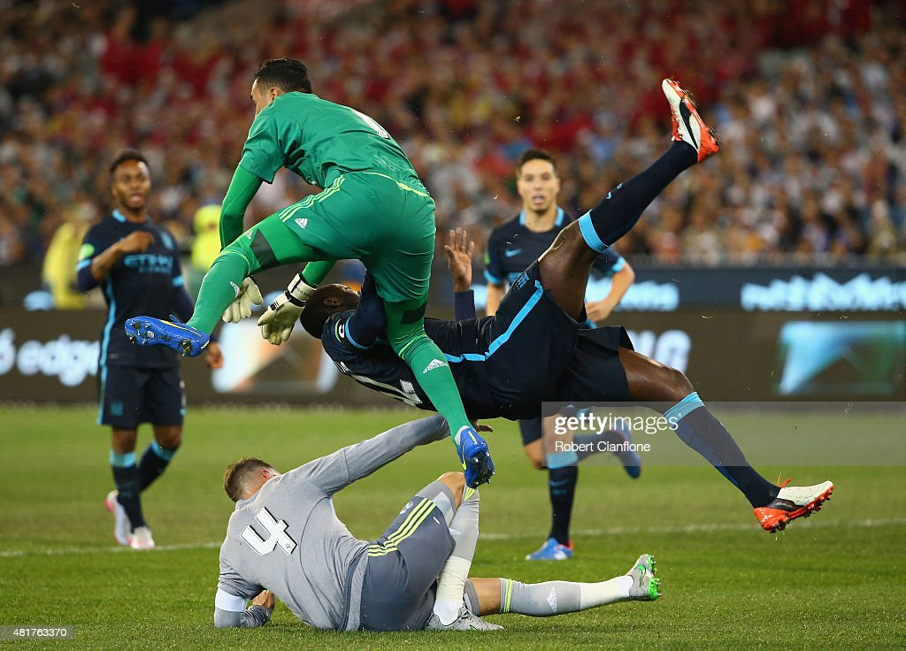 Yaya Toure of Manchester City collides with Real Madrid goalkeeper Keilor Navas during the International Champions Cup match between Real Madrid and Manchester City at Melbourne Cricket Ground on July 24, 2015 in Melbourne, Australia.