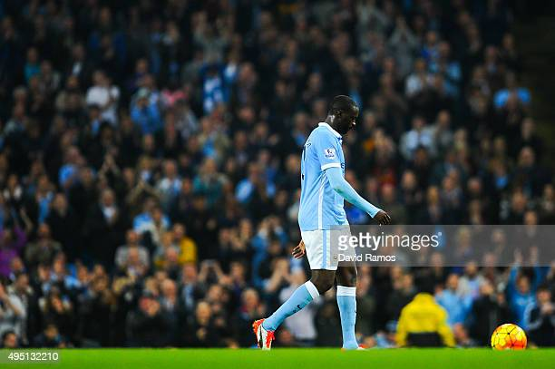 Yaya Toure of Manchester City FC looks down as he walks out the pitch being substituted during the Barclays Premier League match between Manchester...