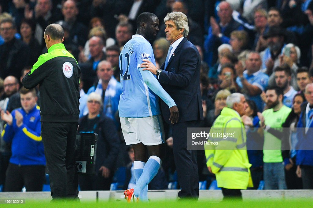 Yaya Toure of Manchester City FC talks with his Head Coach Manuel Pellegrini of as he is being substituted during the Barclays Premier League match between Manchester City and Norwich City at Etihad Stadium on October 31, 2015 in Manchester, England.