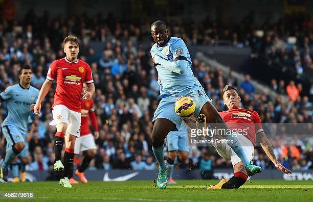 Yaya Toure of Manchester City goes down in the area after a challenge from Marcos Rojo of Manchester United during the Barclays Premier League match...