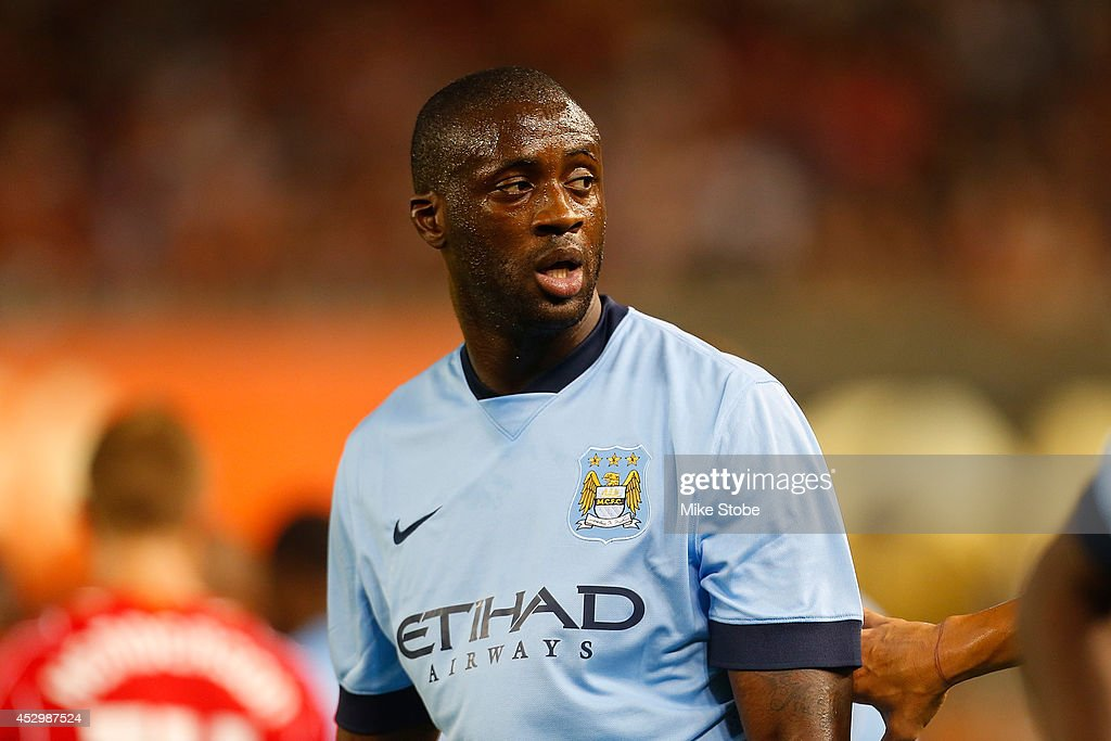 <a gi-track='captionPersonalityLinkClicked' href=/galleries/search?phrase=Yaya+Toure&family=editorial&specificpeople=550817 ng-click='$event.stopPropagation()'>Yaya Toure</a> #42 of Manchester City in action against Liverpool during the International Champions Cup 2014 at Yankee Stadium on July 30, 2014 in the Bronx borough of New York City.