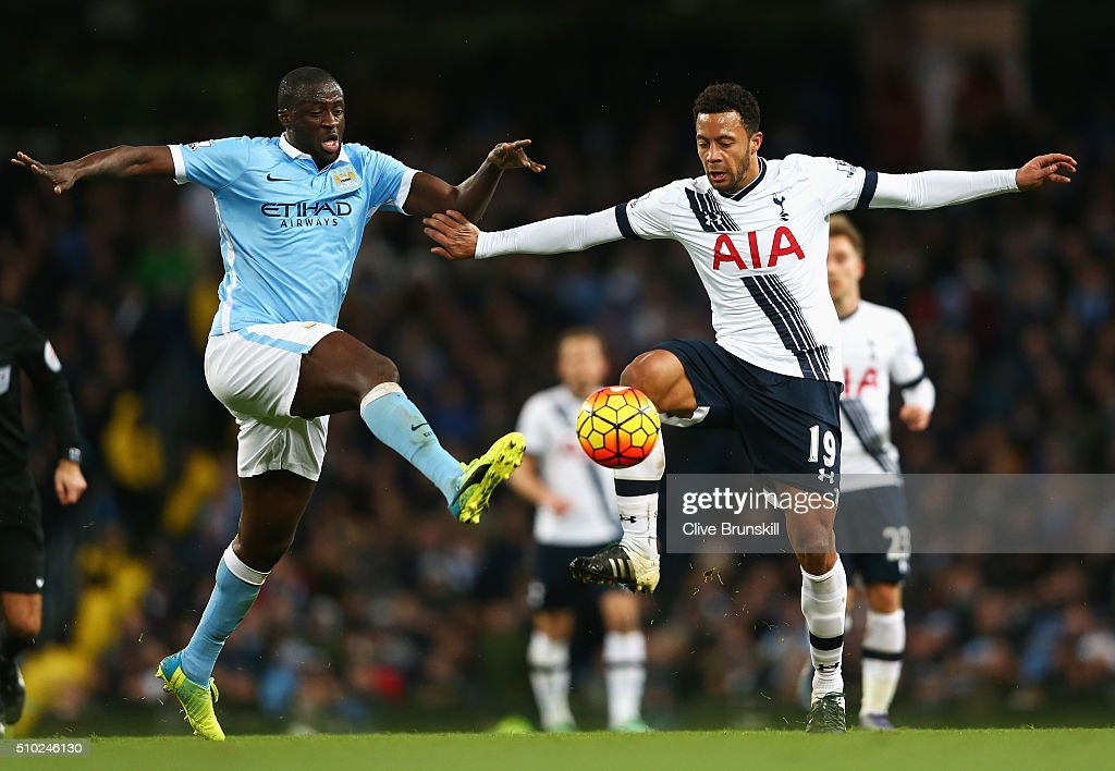 Yaya Toure of Manchester City is challenged by Mousa Dembele of Tottenham Hotspur during the Barclays Premier League match between Manchester City and Tottenham Hotspur at Etihad Stadium on February 14, 2016 in Manchester, England.