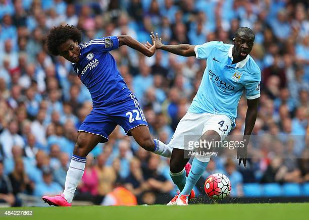 Yaya Toure of Manchester City is challenged by Willian of Chelsea during the Barclays Premier League match between Manchester City and Chelsea at the...