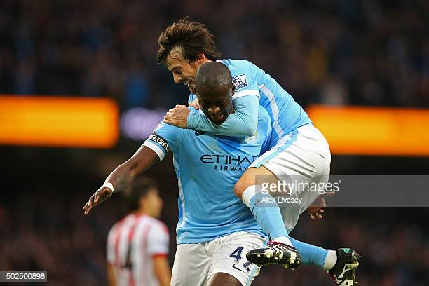 Yaya Toure of Manchester City is congratulated by teammate David Silva after scoring his team's second goal during the Barclays Premier League match...