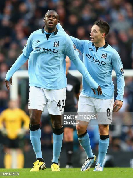 Yaya Toure of Manchester City is congratulated by teammate Samir Nasri after scoring his team's first goal to make the score 12 during the Barclays...