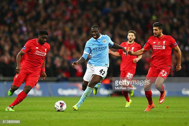 Yaya Toure of Manchester City is foiled by Kolo Toure and Emre Can of Liverpool during the Capital One Cup Final match between Liverpool and...