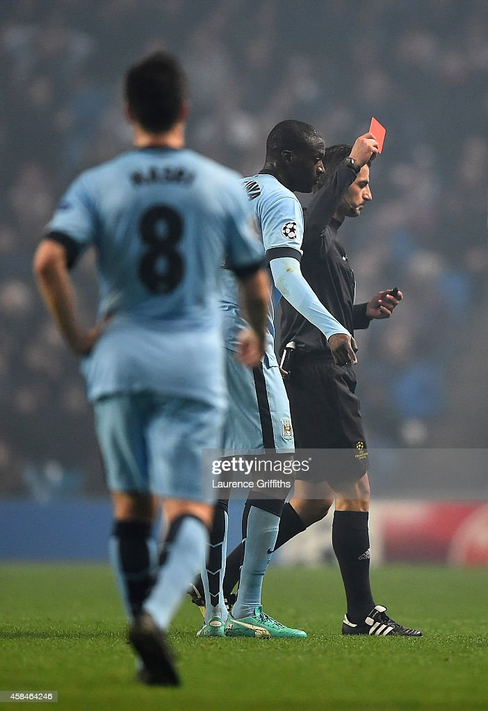 Yaya Toure of Manchester City is shown a red card by Referee Tasos Sidriopoulos during the UEFA Champions League Group E match between Manchester City and CSKA Moscow on November 5, 2014 in Manchester, United Kingdom.
