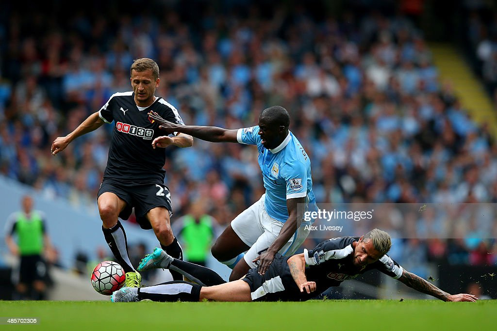Yaya Toure of Manchester City is tackled by Valon Berami of Watford during the Barclays Premier League match between Manchester City and Watford at Etihad Stadium on August 29, 2015 in Manchester, England.