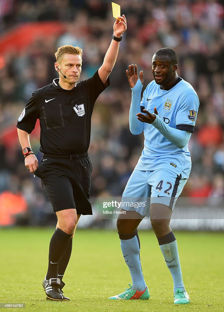 Yaya Toure of Manchester City reacts as referee <a gi-track='captionPersonalityLinkClicked' href=/galleries/search?phrase=Mike+Jones+-+%C3%81rbitro&family=editorial&specificpeople=7275880 ng-click='$event.stopPropagation()'>Mike Jones</a> shows a second yellow card to Eliaquim Mangala of Manchester City (not pictured) adn is sent off during the Barclays Premier League match between Southampton and Manchester City at St Mary's Stadium on November 30, 2014 in Southampton, England.