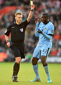 Yaya Toure of Manchester City reacts as referee Mike Jones shows a second yellow card to Eliaquim Mangala of Manchester City adn is sent off during...
