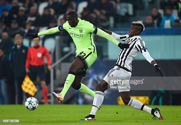 Yaya Toure of Manchester City rides the challenge from Paul Pogba of Juventus during the UEFA Champions League group D match between Juventus and...