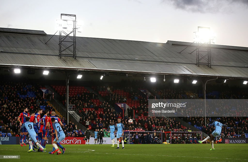 Yaya Toure of Manchester City scores his sides third goal from a free kick during the Emirates FA Cup Fourth Round match between Crystal Palace and Manchester City at Selhurst Park on January 28, 2017 in London, England.