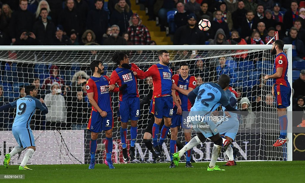 Yaya Toure of Manchester City scores his side's third goal from a free kick during the Emirates FA Cup Fourth Round match between Crystal Palace and Manchester City at Selhurst Park on January 28, 2017 in London, England.