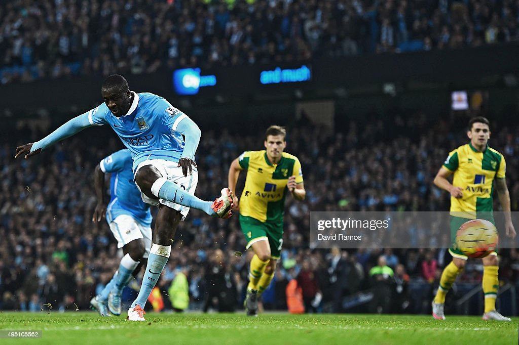 Yaya Toure of Manchester City scores his team's second goal from the penalty spot during the Barclays Premier League match between Manchester City and Norwich City at Etihad Stadium on October 31, 2015 in Manchester, England.