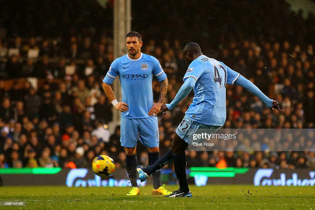 <a gi-track='captionPersonalityLinkClicked' href=/galleries/search?phrase=Yaya+Toure&family=editorial&specificpeople=550817 ng-click='$event.stopPropagation()'>Yaya Toure</a> of Manchester City scores the first goal from a freekick during the Barclays Premier League match between Fulham and Manchester City at Craven Cottage on December 21, 2013 in London, England.