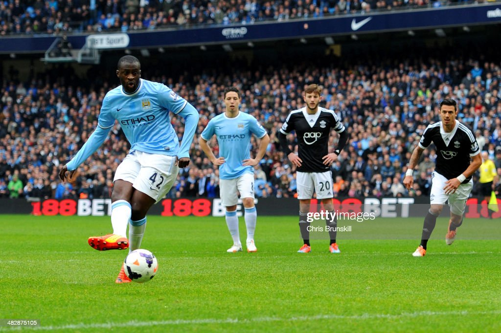 <a gi-track='captionPersonalityLinkClicked' href=/galleries/search?phrase=Yaya+Toure&family=editorial&specificpeople=550817 ng-click='$event.stopPropagation()'>Yaya Toure</a> of Manchester City scores the opening goal from the penalty spot during the Barclays Premier League match between Manchester City and Southampton at Etihad Stadium on April 5, 2014 in Manchester, England.