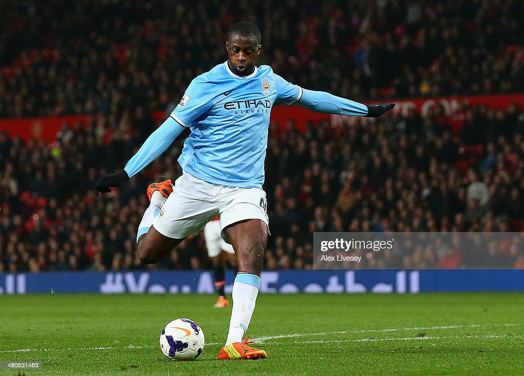 Yaya Toure of Manchester City scores the third goal during the Barclays Premier League match between Manchester United and Manchester City at Old Trafford on March 25, 2014 in Manchester, England.
