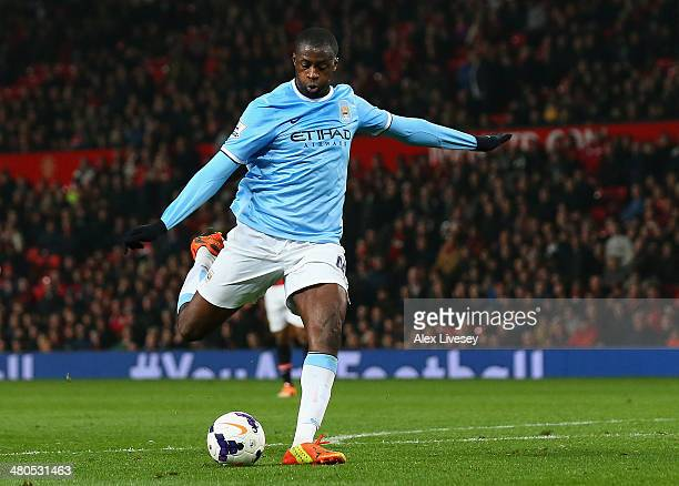 Yaya Toure of Manchester City scores the third goal during the Barclays Premier League match between Manchester United and Manchester City at Old...