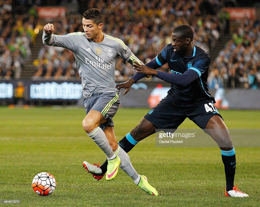 Yaya Toure of Manchester City tackles Cristiano Ronaldo of Real Madrid during the International Champions Cup match between Real Madrid and Manchester City at Melbourne Cricket Ground on July 24, 2015 in Melbourne, Australia.
