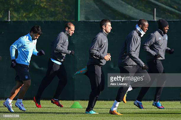 Yaya Toure of Manchester City warms up during a training session at the Carrington Training Ground on November 5 2012 in Manchester England