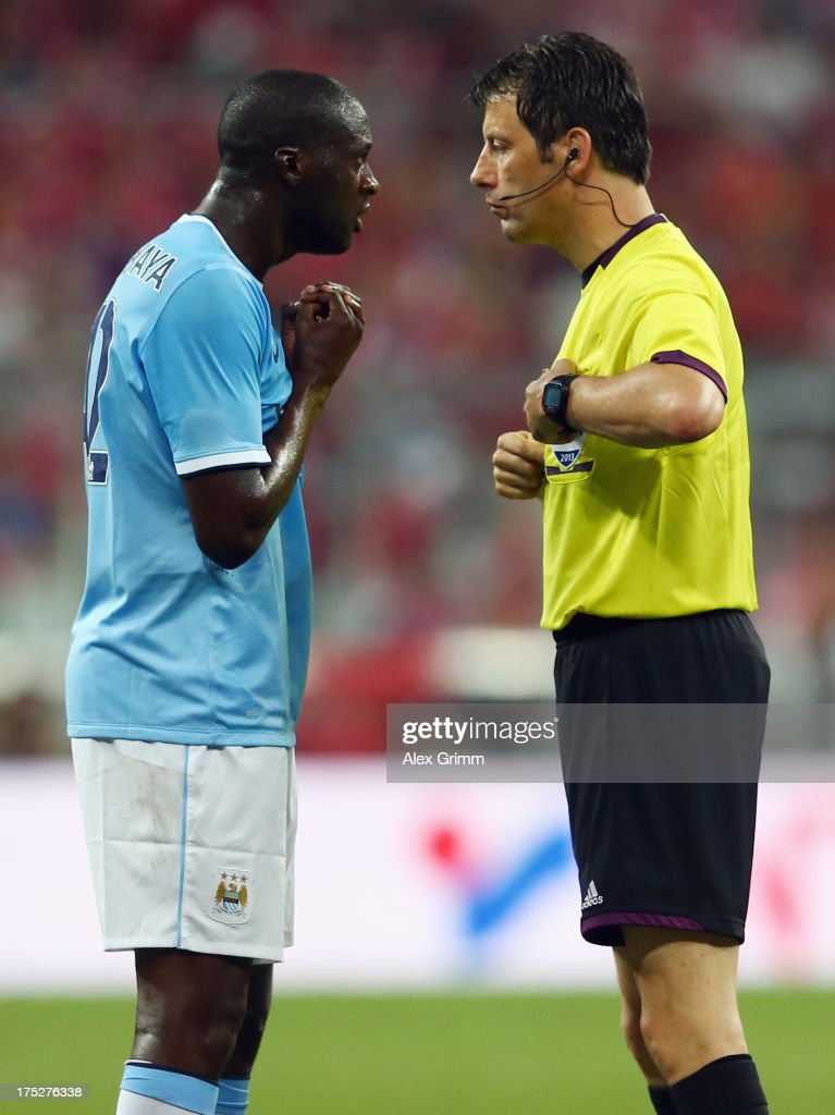 Yaya Toure of Manchester discusses with referee Wolfgang Stark during the Audi Cup Final match between FC Bayern Muenchen and Manchester City at Allianz Arena on August 1, 2013 in Munich, Germany.