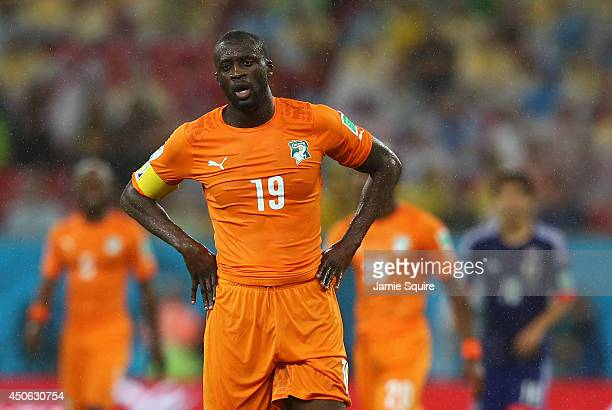 Yaya Toure of the Ivory Coast looks on in the rain during the 2014 FIFA World Cup Brazil Group C match between the Ivory Coast and Japan at Arena...