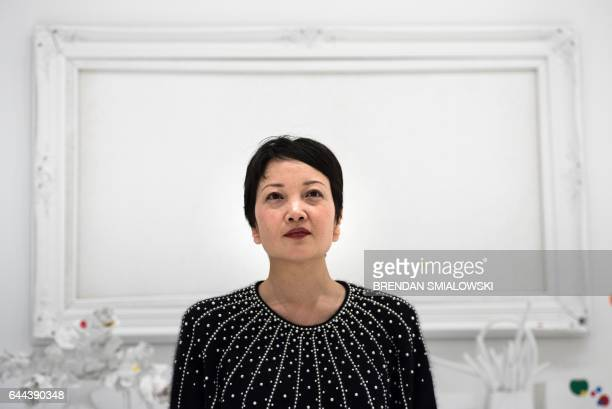 Yayoi Kusama's Infinity Mirrors exhibition curator Mika Yoshitake poses in the obliteration room at the Hirshhorn Museum February 21 2017 in...