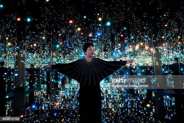 Yayoi Kusama's Infinity Mirrors exhibition curator Mika Yoshitake poses its the Souls of Millions of Light Years Away at the Hirshhorn Museum...