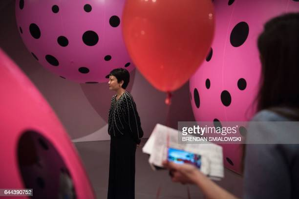 Yayoi Kusama's Infinity Mirrors exhibition curator Mika Yoshitake stands near the Dots Obsession Love Transformed into Dots during an interview at...