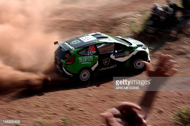 Yazeed Al Rahji of Saudi Arabia and British codriver Michael Orr drive their Ford Fiesta S2000 during the Klenia special stage of the WRC Acropolis...