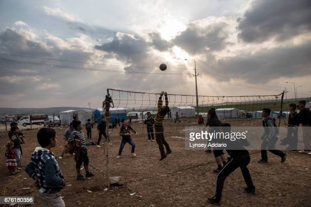 Yazidi children play vollyball in the Sharia camp outside Dohuk January 24 2016 Yazidismany of whom have suffered at the hands of ISISare living in...
