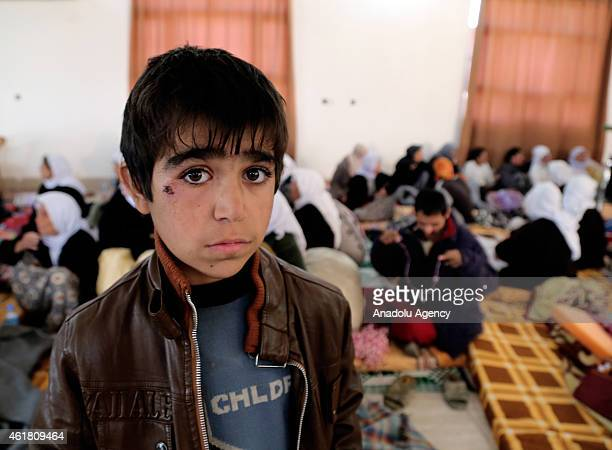 Yazidi kid 8year old Murat Hidir freed by Islamic State of Iraq and the Levant militants are seen in Kirkuk Iraq on January 18 2015 ISIL freed...
