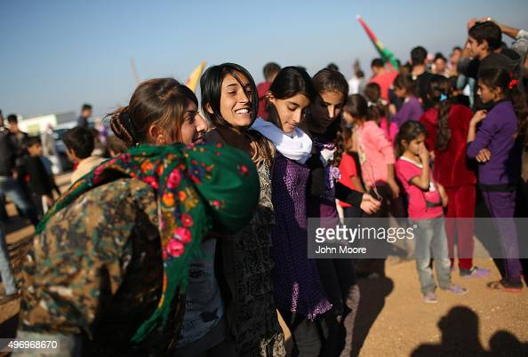 Yazidi refugees celebrate news of the liberation of her homeland of Sinjar from ISIL extremists while at a refugee camp on November 13 2015 in Derek...