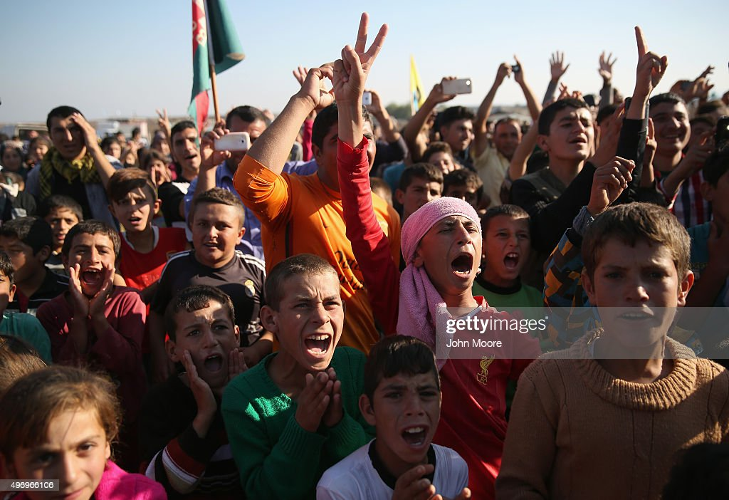 Yazidi refugees celebrate news of the liberation of their homeland of Sinjar from ISIL extremists while at a refugee camp on November 13 2015 in...