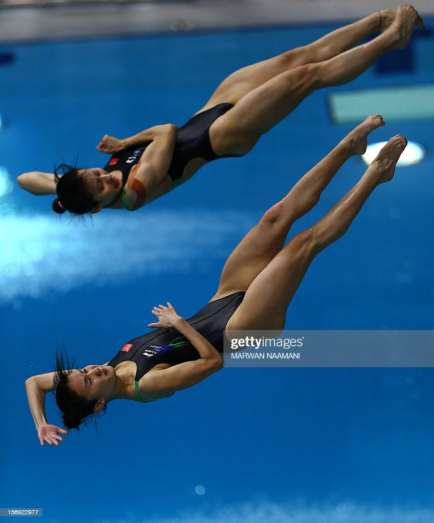 Ye Chen and Lin Qu of China dive to win the gold medal in the Women's synchronised 3m springboard at the 9th Asian Swimming Championships in Dubai, November 25, 2012.