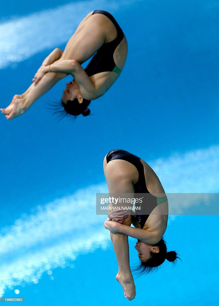 Ye Chen and Lin Qu of China dive to win the gold medal in the Women's synchronised 3m springboard at the 9th Asian Swimming Championships in Dubai, November 25 2012.