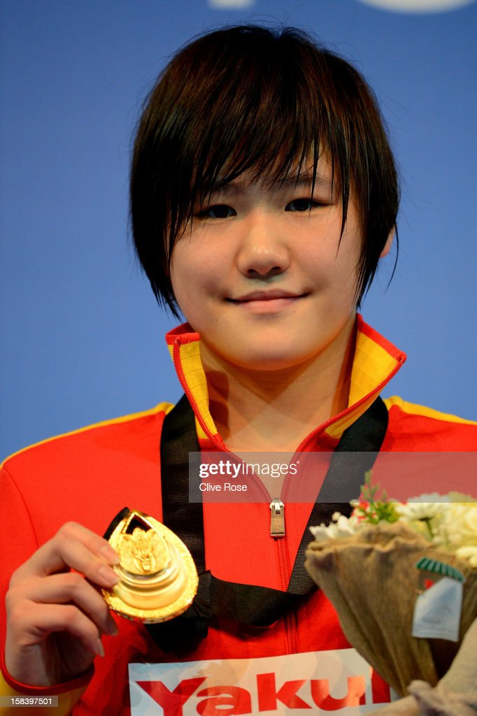 <a gi-track='captionPersonalityLinkClicked' href=/galleries/search?phrase=Ye+Shiwen+-+Swimmer&family=editorial&specificpeople=7402437 ng-click='$event.stopPropagation()'>Ye Shiwen</a> of China poses with her Gold medal the podium after winning the Women's 200m Individual Medley Final during day four of the 11th FINA Short Course World Championships at the Sinan Erdem Dome on December 15, 2012 in Istanbul, Turkey.