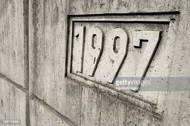 Year 1997 is cast into a concrete wall