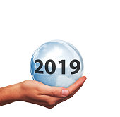 Hand with crystal ball and year 2019