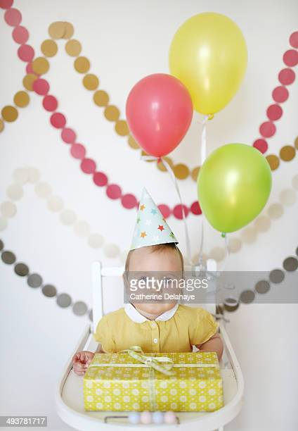A 1 year baby girl celebrates her first birthday