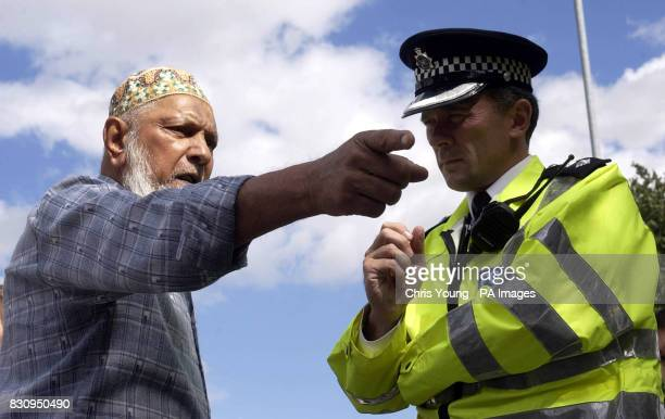 74 year old Abdul Rasid Suhotoo voices his concerns to the Police outside the Finsbury Park Mosque in North London as worshipers brace themselves for...