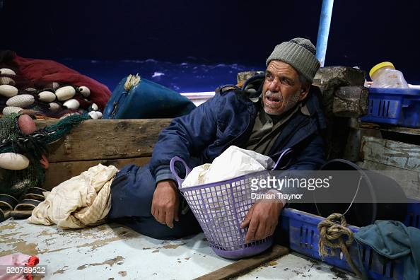 65 year old Abu Ashraf keeps low on the deck as waves rock the boat on April 9 2016 in Gaza City Gaza In early April Israel expanded the area...