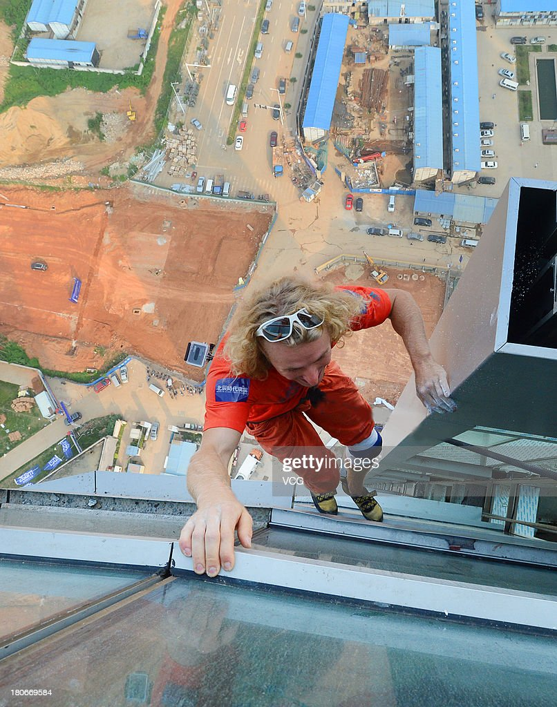 24 - year - old Austrian climber Michael Kemeter climbs the tallest skyscraper in Changsha on September 15, 2013 in Changsha, Hunan Province of China. It took Kemeter one hour to climb from the ground to the 45th floor, reaching a height of about 200 meters, without any protective measures.